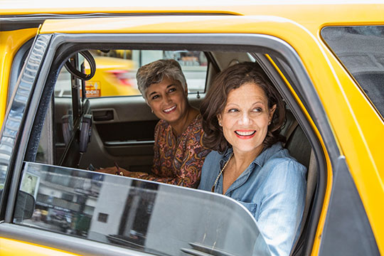 two women sharing a taxi