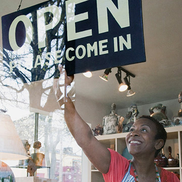 woman-shop-owner-smiling