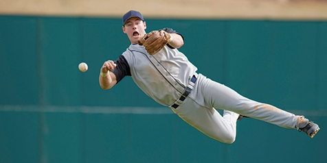 Baseball player catching ball